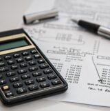 Accountants calculator and pen